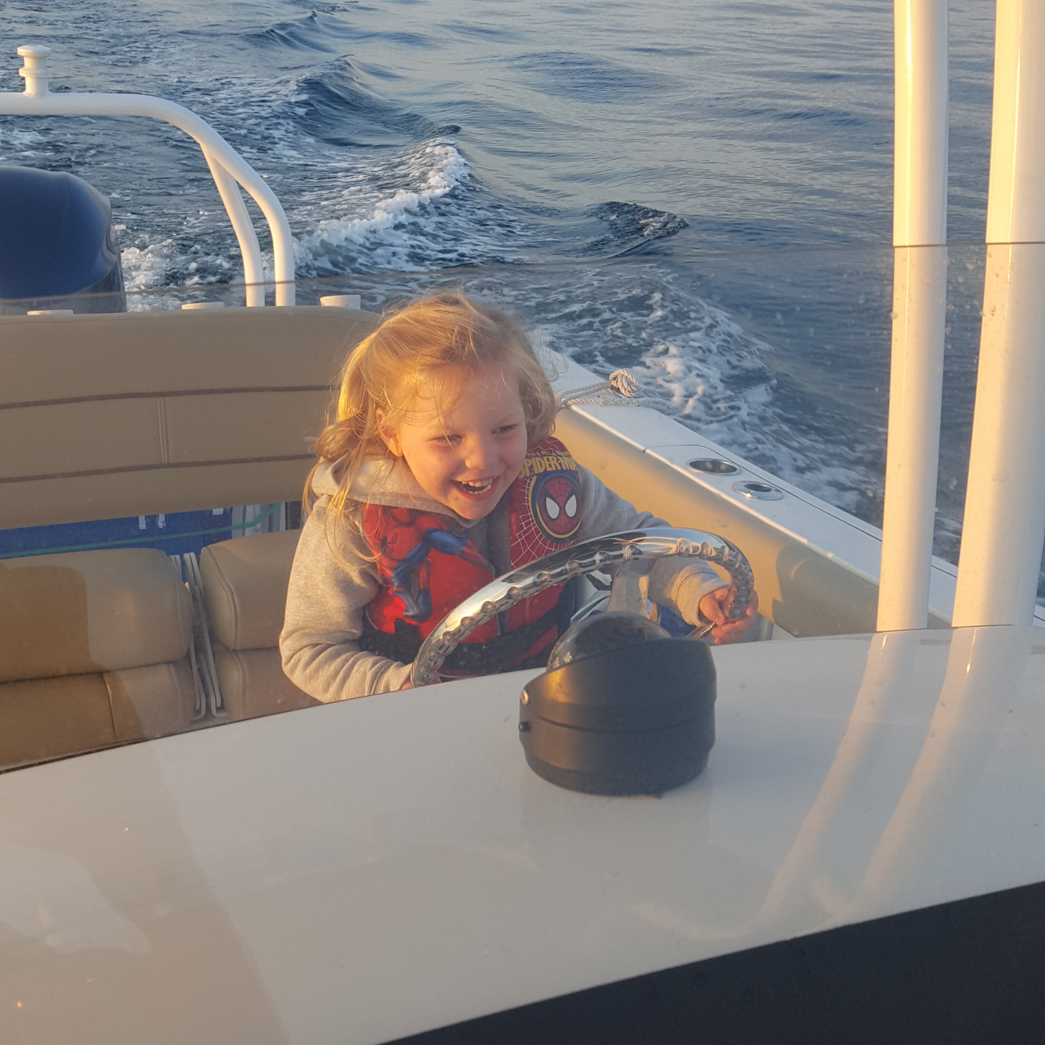 Title: Can I Drive Dada? - On board their Sportsman Open 232 Center Console - Location: Plymouth MA, off Clarks Island. Participating in the Photo Contest #SportsmanDecember2017