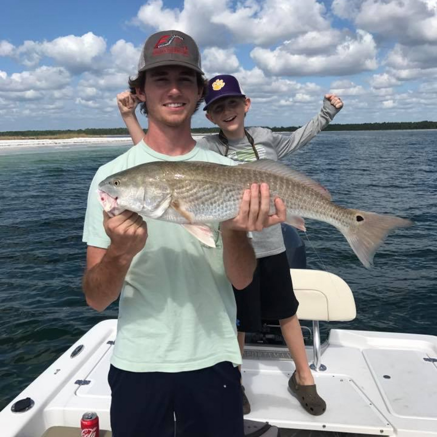Title: Nathan's first slot Redfish - On board their Sportsman Island Bay 20 Bay Boat - Location: Panama City Florida n. Participating in the Photo Contest #SportsmanNovember2017